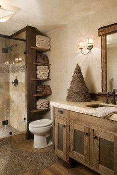 pebbles on wood. Wood accents. Tile in shower. Open shelving. Lighting. #BathroomDesignIdeas