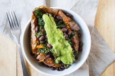 Loaded Sweet Potato Two medium sweet potatoes  1 can black beans, drained and rinsed  1 bunch kale  1 tbsp extra virgin olive oil  1 clove garlic, minced  salt and pepper to taste  Green Goddess Dressing to serve