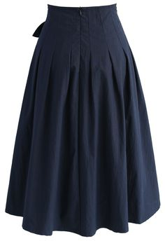 The classy navy midi skirt serves up traditional chic with its button-down detail and simple silhouette. The bowknot at the waste adds a fun, feminine component that'll make this even easier to style! - Self-tie bow on waist - Buttons decorated front - Pleats from waist - Concealed back zip closure - Lined - 100% Polyester - Hand wash cold Size(cm)Length Waist XS 69 64 S 69 68 M 69 72 L 69 76 XL 6...