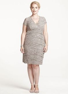 Sparkle and shine in this fabulous lace and sequin Mother of the Bride dress!  Cap sleeve bodice features ultra feminine lace and dazzling sequin detail.  Tiered skirt adds dimension and creates a flattering silhouette.  Fully lined. Side zip. Imported nylon/poly blend. Hand wash. Also available in missy sizes as Style S256930.