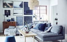 A blue, white and gray living room.