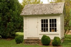 Tool shed with large double window/ If a level surface is difficult to find in your yard, consider constructing foundation like the one featured in this image.
