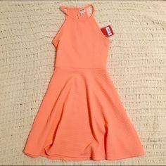 Coral Halter Mini Dress Soooo in love with this dress, only selling because it does not fit me! Very summery/springy and the neck is super cute , New with tags! ⭐️If you have any questions feel free to ask! Really want to sell this one soon so consider purchasing! Dresses Mini