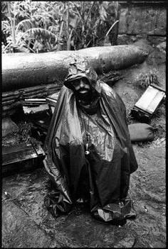 Director Francis Ford Coppola shelters himself from the driving rain that added to the troubles of an already beleaguered shoot for Apocalypse Now, 1979 /photos by Mary Ellen Mark