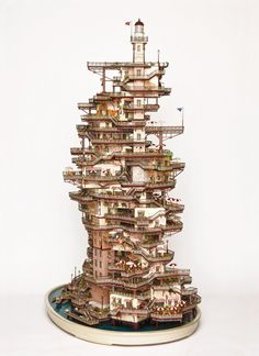 This artist carves miniature and complex dwellings in the branches of bonsai