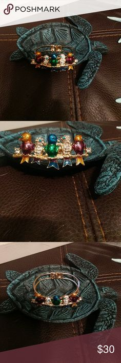 Betsey Johnson Bird Bracelet Beautiful Crystal and enamel birds adorn this gold toned hinge bracelet. Fits a larger sized wrist as well as standard and small. Betsey Johnson Jewelry Bracelets