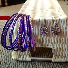 Purple bangles and purple peace sign earrings Purple bangles, and purple peace sign earrings with silver rhinestones. Only worn a couple of times. Jewelry
