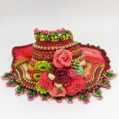 Unique beaded crochet cuff in dark red, light green, dark green, light rose and coral colors. This bracelet crochet from cotton thread, is decorated with glass seed beads, toho japanese beads. Тhe beads are variants of green, red and coral colors. The bracelet is made with the