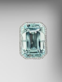 Emerald Cut Aquamarine Ring with Diamonds
