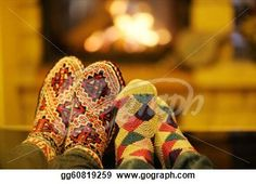 """Happy Young romantic couple sitting on sofa in front of fireplace at winter season in home"" - Winter Stock Photo from Gograph.com"