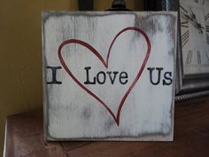 I Love Us hand painted wood sign. This sign would be great for that special someone. Great Valentine gift or just because....  8x8 sign that is stained on front and back, a light cream color placed on top with black words and a dark red heart. A coat of polyurethane is painted on and a saw tooth hanger is placed on the back. Each piece of wood I use is a little different due to the knots and grains. This will make it so not two signs will look exactly a like. Sanding and distressing also…