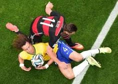 """""""Brazil's defender David Luiz (L) and Germany's forward Miroslav Klose challenge for the ball during the semi-final football match between Brazil and  Germany WC2014"""