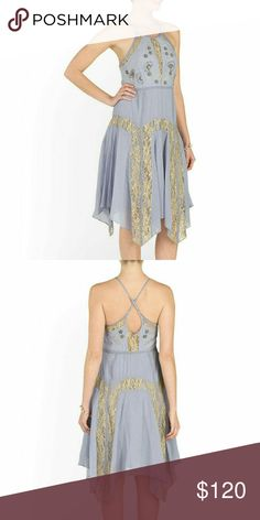 NWT Free People Dress A lovely dress you can dance the night away. The dress is sleeveless and has a scoop neck. Also, this dress have a lace trim, embroidered detail, adjustable shoulder straps, cross back with keyhole opening and crinkle texured. This dress is brand new and never worn. Dress Color: Lilac Free People Dresses