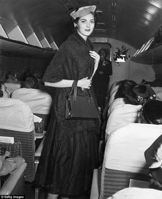 Long career: Carmen, pictured in 1955 at the age of 23 in the aisle of an airplane, says, 'when I die, it's going to be my way'