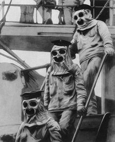 Sailors wearing protective suits and sinister gas masks on board an Austrian battleship, July 1916.