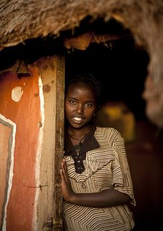Miss Tume, shy daughter of Wako, a Borana chieftain - Kenya by Eric Lafforgue via Flickr. Vist his Flickr page, read the entries. They are worth it.
