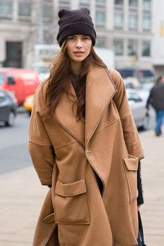 A brown oversized coat and a sock hat