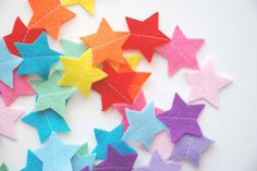 Add a splash of colour with this fun rainbow star garland. Made by hand, each brightly coloured star is sewn into the garland to create a long line of fun colour! Details: 5 feet / long, with approx 45 stars, each Wool felt. Handmade in Eng. Star Garland, Felt Garland, Bunting Garland, Buntings, Felt Bunting, Bunting Ideas, Bunting Flags, Rainbow Star, Rainbow Baby