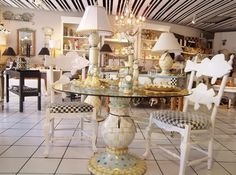 Call our fashion boutique at in Naples, FL, for the latest in women's apparel and accessories. Mackenzie Childs Furniture, Ceramic Table, Fashion Boutique, Dining Table, Table Decorations, Decorating, Clothes For Women, Home Decor, Decor