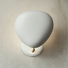 Originally designed by Greta Grossman, the Gubi lighting Cobra Wall Sconce is an organic fixture that represents a unique moment where California mid-century modernism became internationally recognized as a distinct style. A successor to the table lamp which won the Good Design Award in 1950, the Cobra collection represents features finely tuned movement with a smooth profile. The hooded shade can change the type of light in an instant; the shade can be adjusted vertically 90 degrees as well…