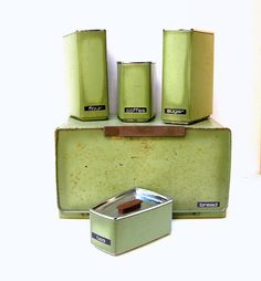 FABULOUS VINTAGE CANISTER AND BREADBOX SET.  AVOCADO GREEN, 1960s KITCHEN DECOR.  I have this Canister Set in Gold.  Would love to find the Bread Box to go along with it! (LP)