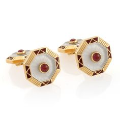 A pair of Italian Estate 18 karat gold and enamel cufflinks with rubies and crystal by Vennari, Firenze. The cufflinks have 4 cabochon rubies with an approximate total weight of .40 carats set in carved crystal. The double sided cufflinks are in an octagonal shape.  Available exclusively at Macklowe Gallery.