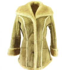Stay warm and in style with this authentic 70s sheepskin shearling coat! It uses all of the highest quality materials and has been given the woolmark that s