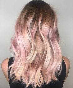 Balayage is an alternative technique to traditional salon highlighting with foils. Your colorist can literally paint highlights precisely where the sun would actually hit your hair. Rose gold balayage is the love chil. Blond Rose, Blonde With Pink, Rose Gold Hair Blonde, Blonde Hair With Pink Highlights, Rose Gold Highlights, Blonde Pink Balayage, Rose Gold Ombre, Rose Pink Hair, Rose Gold Bayalage