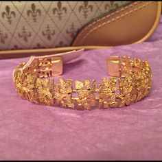 Beautiful gold adjustable bracelet This is so gorgeous and has an amazingly flexible way of custom fitting your wrist. New with retail tags. Never worn or tried on. Jewelry Bracelets