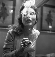 Blowing smoke - actress Janet Leigh (1927-2004), date unknown.