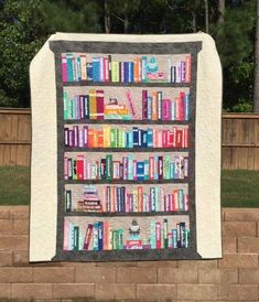 Looking for your next project? You're going to love Selvage Bookshelf Quilt by designer jessicaquilter.