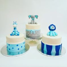 Blue baby shower cakes for a chic modern boy baby shower - elephant giraffe lion
