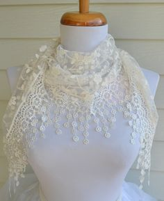 Gorgeous white lace scarf. Scarf is a triangle shape, like a shawl, and has beautiful details.                                                                                                                                                                                 More
