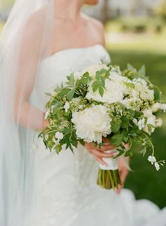 Chic Coastal Wedding in Maryland, Green and White Spring Bouquet with Peonies and Bleeding Heart | Brides.com