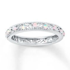 This stackable band is set with 16 lab-created opals inside two beaded edges. The band is 3.5mm wide.