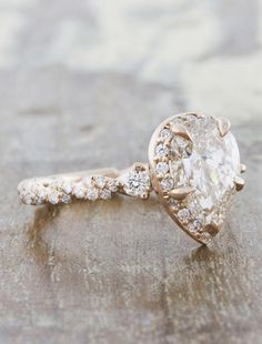The Nolah is vintage flare and flamboyance wrapped up in one - with an pear shaped diamond in an elegant twisted band with floral accents. by Ken & Dana Design.
