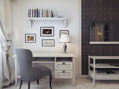 Beautiful Small Home Office Decorating Idea showing White Desk and Table Lamp and Gray Armless Chair and Wall Bookshelves also Wall Mounted LED TV and White Painted Wall and Wallpaper Decor