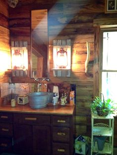 Galvanized bucket sink with wall mount faucet  DIY electrified lanterns with Barnwood shelves And Barnwood walls my master bathroom