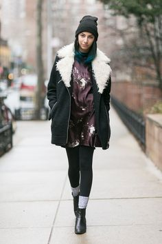 Talia Rochas is a junior at F.I.T. and studies fashion merchandising. Her coat is Topshop, her dress is thrifted, her turtleneck H&M, and her boots Anne Klein.