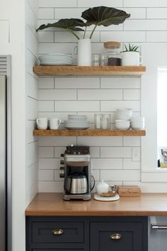 """The countertops are BauBuche Countertops. """"This was something that was sourced locally, and I have not been able to find anywhere on the web that sells this!""""  They used these steel brackets to make floating shelves. The white tile for the backsplash is from the Discount Glass Tile Store."""