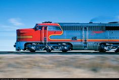 Santa Fe train #75 (the CALIFORNIA SPECIAL) speeds west near Muleshoe in the Texas South Plains. The train originated at Houston the previous evening and is en route to Clovis, New Mexico, and a connection with the SAN FRANCISCO CHIEF. This train was discontinued on July 18, 1968. by Joe McMillan