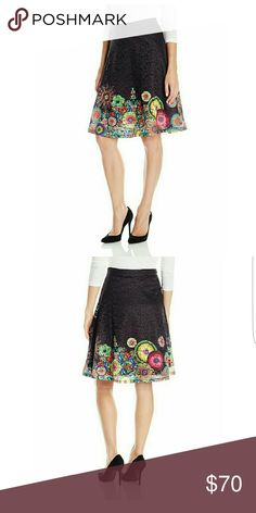 Desigual women's skirt Finland in Black This skirt speaks volumes, classy, flirty and fun.  99% Polyester 1% elastane, fully lined midi skirt. Zip closure with a gorgeous perforated design. Desigual Skirts Midi