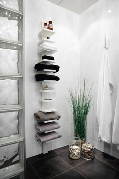 Small bathroom wall storage - could do this between the sink and radiator for towels, flannels and glass jars of cotton wool etc