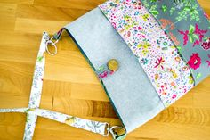Welcome to Part 2 of my Tote with Many Pockets Sewing Pattern! In Part 1,  you will find the materials list and instructions for all of the cutting,  fusing, and sewing of the pockets.  Now it's time to sew the rest of the pieces together. Let's get to it!