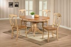 Quails Run Round/Oval Pedestal Dining Table in Almond/Off-White