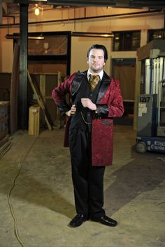 """""""I enjoy having my own costume department in my closet,"""" says Matthew Casella as he attends the Single Carrot Theatre Grand Opening party wearing a burgundy brocade coat donated to the Baltimore Rock Opera Society."""