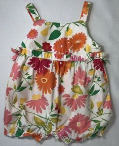 Adorable one piece romper is white with a pretty pink, green, and orange floral print. From the 2004 Floral Palette line. Toddler Girl Romper, Floral Tops, Floral Prints, Girls Rompers, Selling On Ebay, Gymboree, 3 Months, Baby Girls, Pretty In Pink