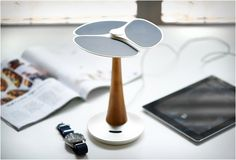 Gingko Solar Tree - Constructed from aluminum, recycled plastic, and bamboo to provide fashionable charging to your iPhone/iPad