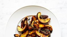 The sweetness of the acorn squash, dates, and coconut oil in this simple roast is balanced by the garlic and woodsy herbs. Acorn Squash Recipes, Pumpkin Squash, Thyme Recipes, Vegetable Recipes, Healthy Meal Prep, Healthy Recipes, Healthy Foods, Thanksgiving Recipes, Fall Recipes