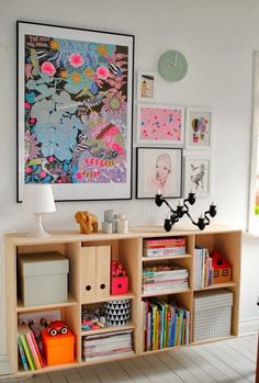 wall mounted bookcase and gallery wall